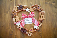 Heart-shaped frame made of cookies and nuts for ch Stock Photos