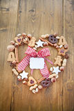 Heart-shaped frame made of cookies and nuts for ch Stock Image