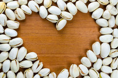 Heart shaped frame made of  pistachio nut Royalty Free Stock Photography