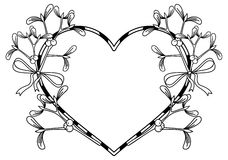 Heart-shaped frame and mistletoe. Royalty Free Stock Photography