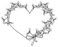 Heart-shaped frame and mistletoe. Royalty Free Stock Photo