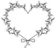 Heart-shaped frame and mistletoe. Copy space. Stock Images