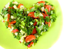 Heart shaped fresh vegetable salad Stock Photos