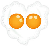 Heart shaped fried double egg. Image representing a heart shaped fried double egg, isolated on white, vector design Royalty Free Stock Image