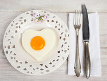 Heart shaped fried egg on beautiful plate Stock Image