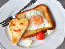 Heart-shaped fried egg and toast Royalty Free Stock Images