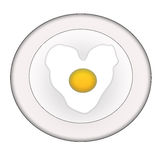 Heart-shaped fried eggs Stock Image