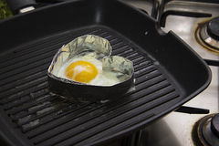 Heart shaped fried eggs Stock Image