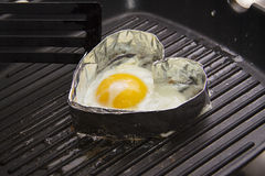 Heart shaped fried eggs Stock Photography