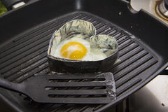 Heart shaped fried eggs Stock Images