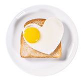 Heart-shaped fried eggs and fried toast isolated Royalty Free Stock Photos