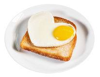 Heart-shaped fried eggs and fried toast isolated Stock Images