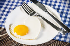 Heart-shaped fried eggs in a plate Royalty Free Stock Photos
