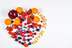 Colorful Heart Shaped Fresh Fruit Arrangement with Choose Health message royalty free stock photos