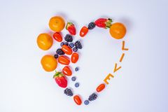 Heart Shaped Fruit Arrangement with the word Live and one empty half for text . stock image