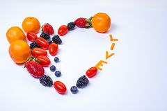 Heart Shaped Fruit Arrangement with word Live on white clean background royalty free stock image