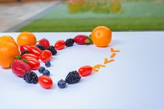 Heart Shaped Fruit Arrangement with the word Live and glass window . royalty free stock photo
