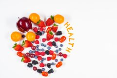 Heart Shaped Fruit Arrangement with the word Health on white background. stock image