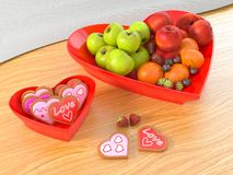 Heart shaped fruit bowl and cookies bowl valentines concept. Heart shaped fruit bowl and cookies bowl for valentine`s day theme in the table royalty free stock photography
