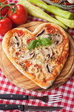 Heart shaped funghi pizza Royalty Free Stock Photography
