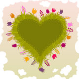 Heart-shaped garden with flowers Stock Images