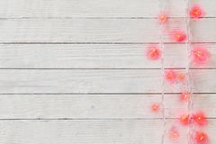 heart-shaped garland on wooden background royalty free stock images