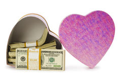 Heart shaped gift box. And dollars inside Stock Photo