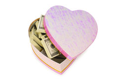 Heart shaped gift box. And dollars inside Stock Images