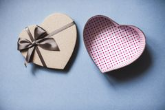 Heart shaped gift box on a blue background top view. Royalty Free Stock Photos