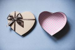 Heart shaped gift box on a blue background top view. Royalty Free Stock Image