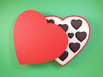 Heart shaped gift box having chocolates. 3D. Stock Images