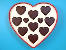 Heart shaped gift box having chocolates. 3D. Royalty Free Stock Photos