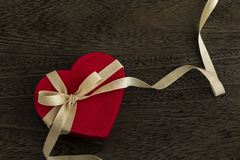 Heart shaped gift box. Heart shaped red gift box tied with ribbon Stock Photos