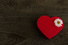 Heart shaped gift box. Heart shaped red gift box on wood background Stock Photography