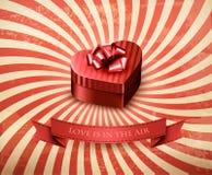 Heart-shaped gift box on retro background. Stock Images