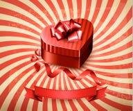 Heart-shaped gift box on retro background. Stock Image