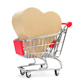 Heart-shaped gift box in a shopping cart Stock Photos