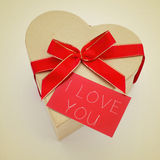 Heart-shaped gift box and signboard with the text I love you, wi Stock Photos