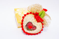Heart-shaped gift box and tied with ribbon. Royalty Free Stock Image