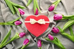 Heart shaped  gift box with tulips on Royalty Free Stock Image