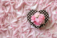 Heart-shaped gift box on  velvet Royalty Free Stock Photos