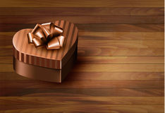 Heart-shaped gift box on wooden background Stock Photo