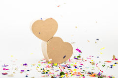 Heart shaped gift boxes with colored confetti royalty free stock images