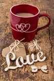 Heart shaped gift and coffee Royalty Free Stock Images
