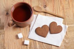 Heart shaped ginger biscuits and a cup of tea royalty free stock photography