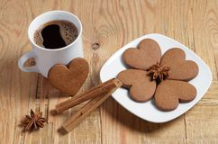 Heart shaped ginger cookies, coffee and spice stock images