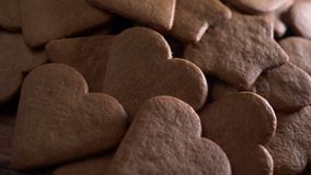 Heart shaped gingerbread, baking stock footage