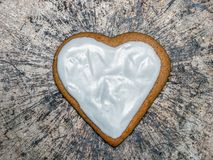 Heart-shaped gingerbread cake with icing stock images
