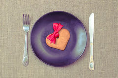 Heart shaped gingerbread cookie on the black plate Stock Images