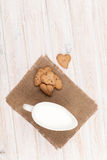 Heart shaped gingerbread cookies and milk pitcher Stock Image